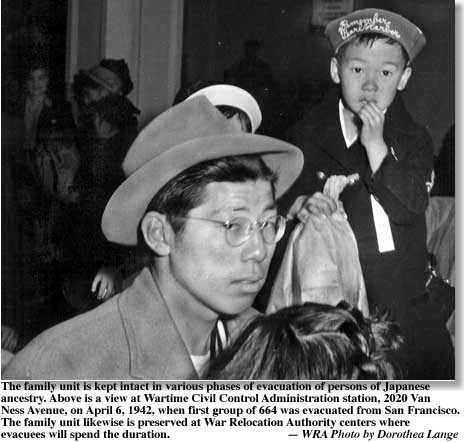 Father and son awaiting deportation to internment camp. Young boy wears Remember Pearl Harbor hat