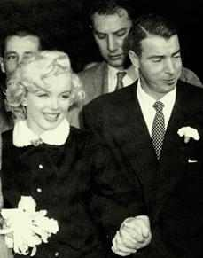 Joe Di Maggio and Marilyn Monroe at San Francisco City Hall after their marriage.
