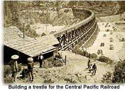 Chinese laborers build Central Pacific Railroad trestle in the Sierra